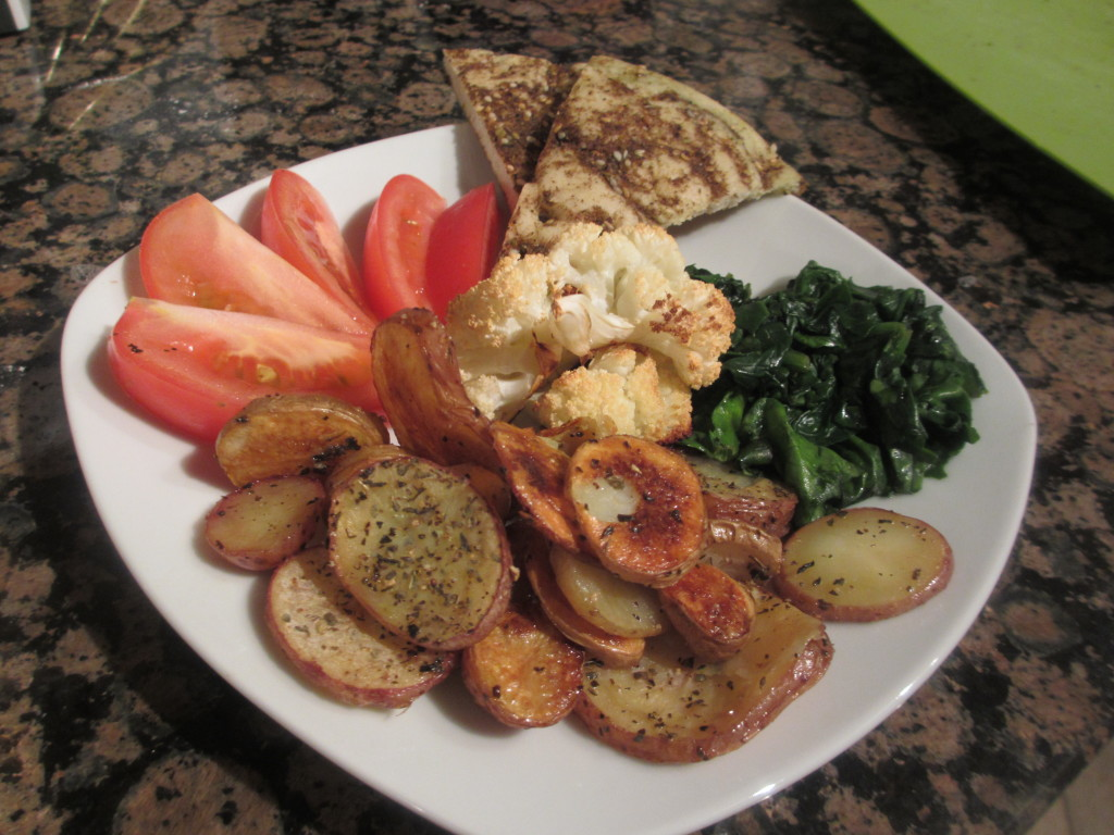 Bread, tomatoes, spinach, potatoes, and cauliflower