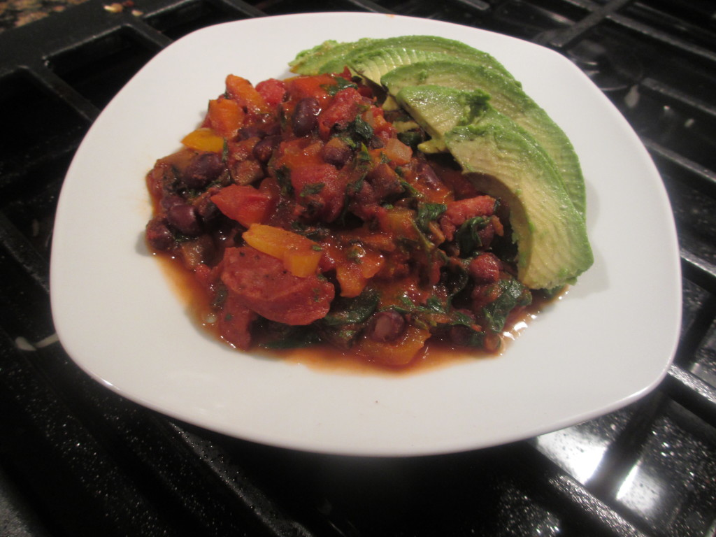Cooked beans, peppers, onions, sausage, and diced tomatoes with avocado