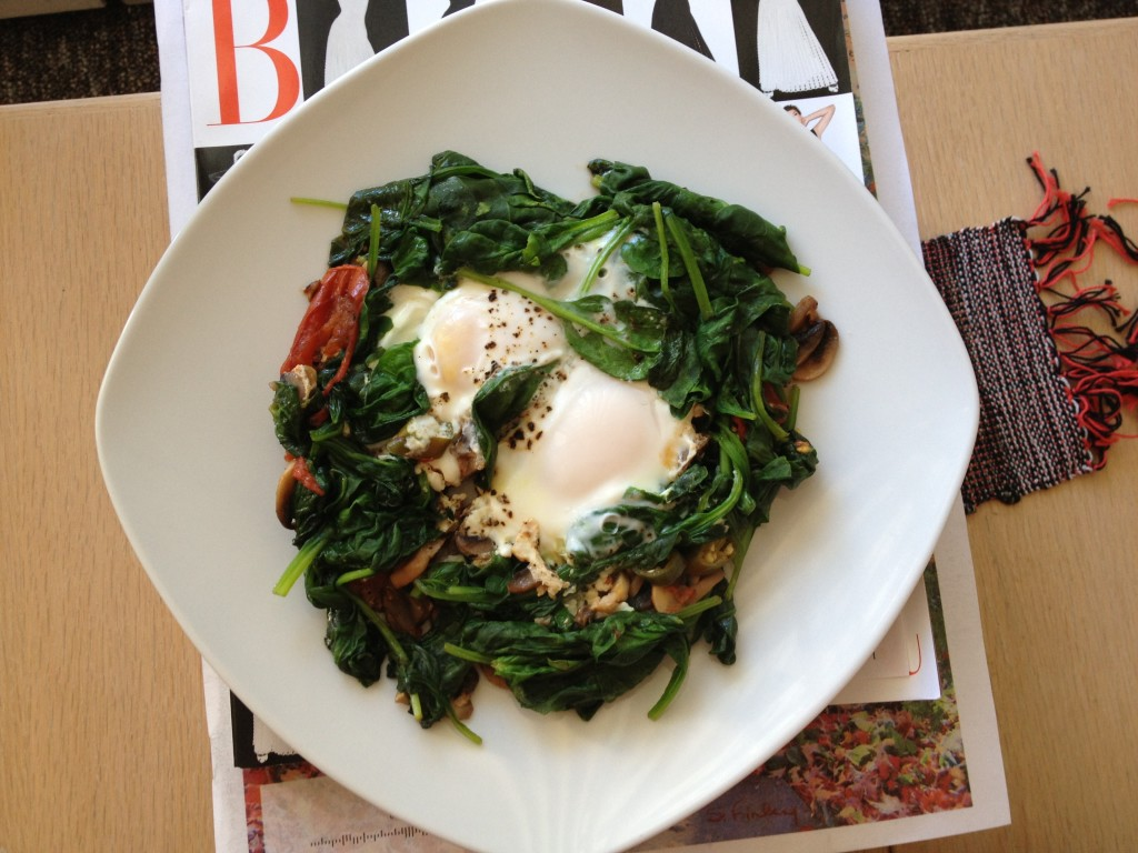 Two sunny side up eggs in a bed of sauteed spinach