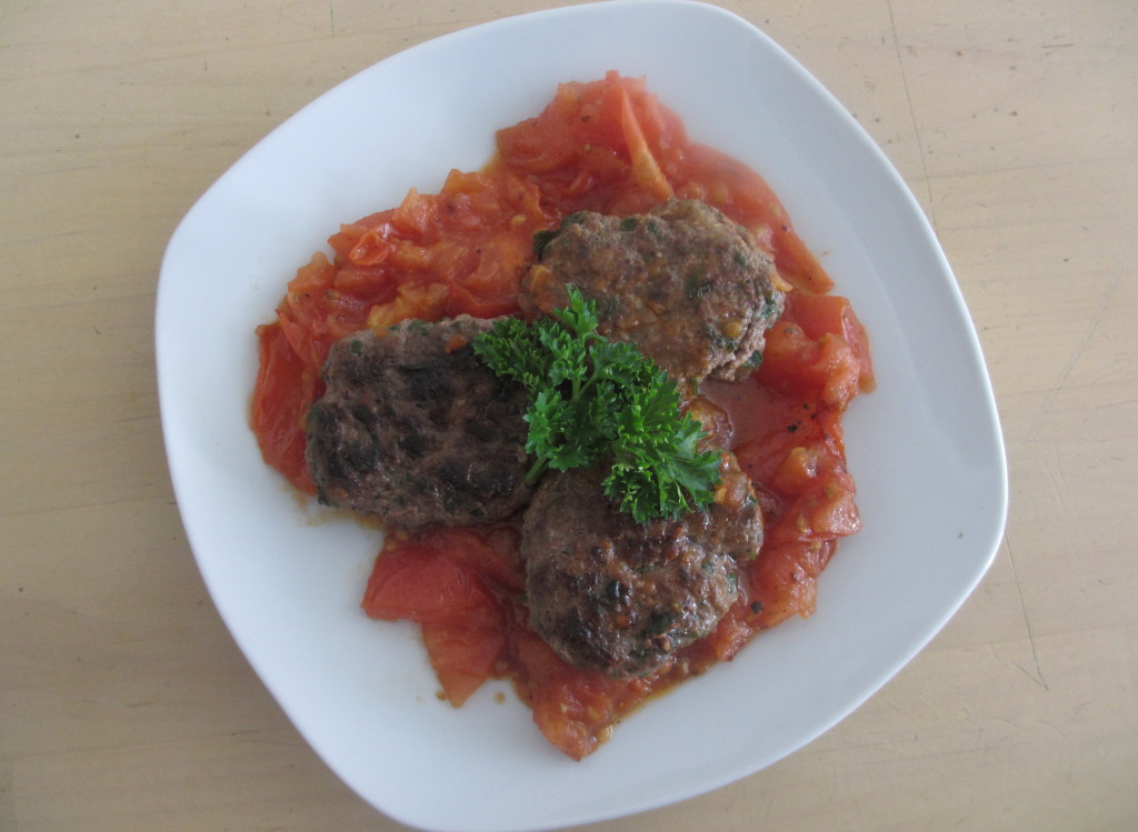 Kafta with fried tomato