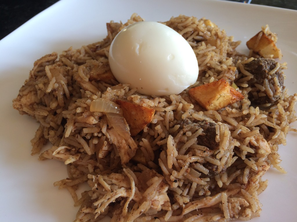 Spiced rice with caramelized onions, potatoes, shredded chicken, and egg